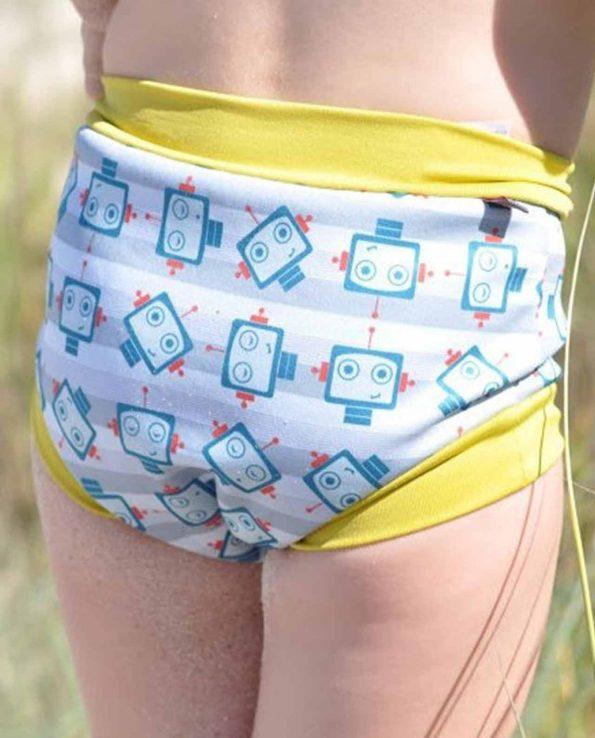 Bañador para niños y bebés ecológico de la marca pop in con estampado de robots